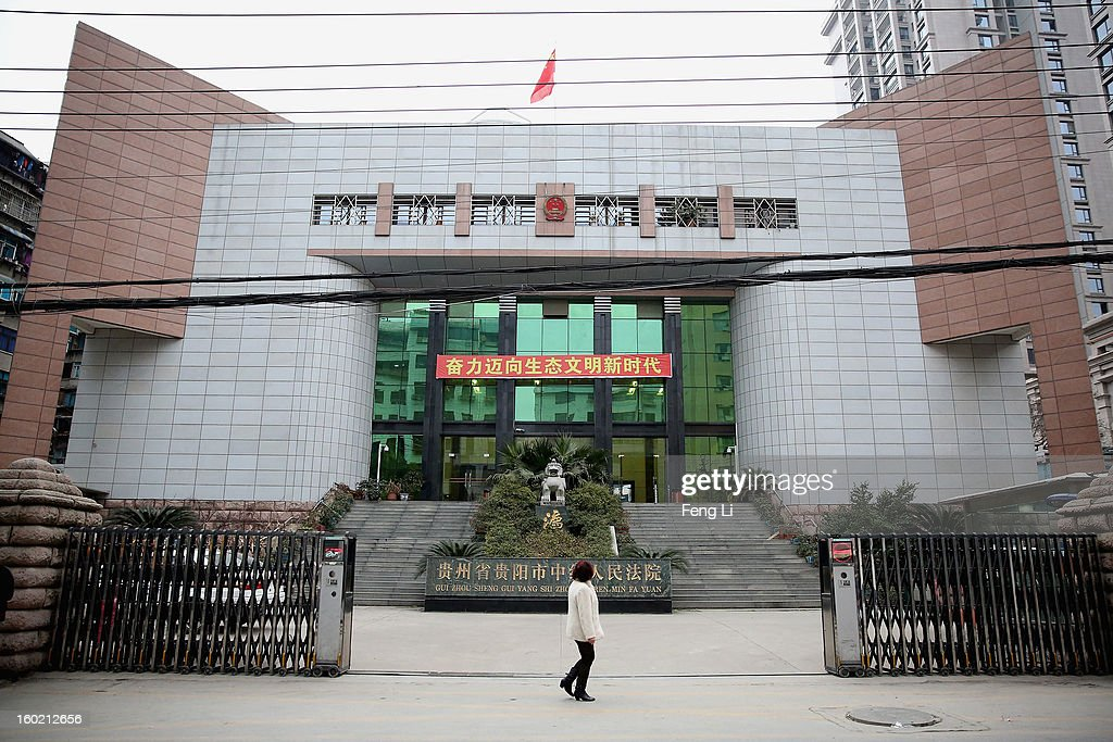 A woman walks outside Guiyang Intermediate People's Court before a press conference on former Chinese leader Bo Xilai's case on January 28, 2013 in Guiyang, China. 'It is fake information. The trial of Bo Xilai will not open in Guiyang today', Vice-president of Guiyang Intermediate People's Court Jiang Hao said. The trial of Bo Xilai is expected to open after the 'two sessions' in March, China's official newspaper Global Times reports on Monday.