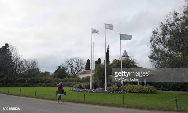 A woman walks outside the Memorial park on August 10 2017 in Pilar Buenos Aires outskirts where Jorge Zorreguieta father of Netherlands' Queen Maxima...