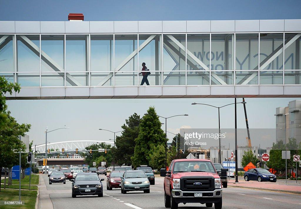 A woman walks over a pedestrian bridge on her way over to Children's Hospital June 24, 2016.