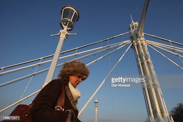 A woman walks over Albert Bridge on the River Thames on February 10 2012 in London England Albert Bridge will be the start point for the flotilla of...