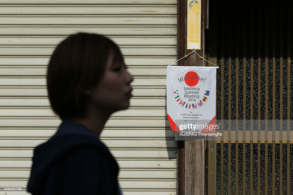 A woman walks pass the G7 Ise-Shima summit flag that hang on entrance of shop at Okage Yokocho, a traditional shopping street on May 5, 2016 in Ise, Japan. The G7 summit will be held in Ise-Shima, Mie prefecture on May 26 and 27, 2016.