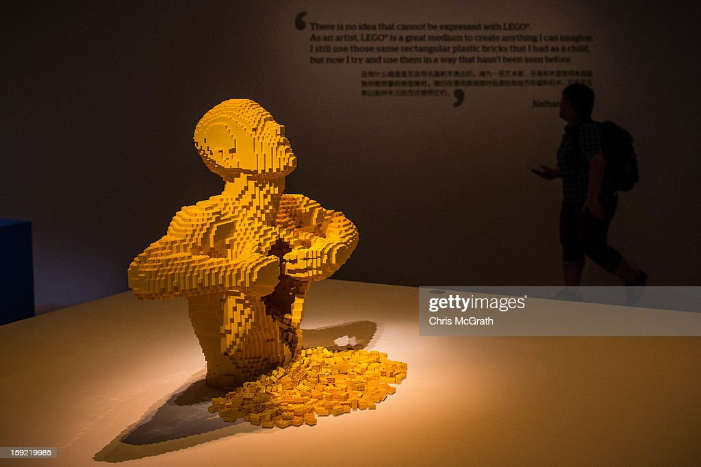 A woman walks passed the Lego sculpture 'Yellow' during the 'The Art of the Brick' exhibition on January 9, 2013 at the ArtScience Museum in Singapore. The exhibition by renowned New York based brick artist Nathan Sawaya features 52 large-scale LEGO brick sculptures and showcases two of the artists iconic pieces 'Yellow' and 'Swimmer'. It is the first time his work has been exhibited in South East Asia. The exhibit runs from 17 Nov 2012 to 14 April 2013.