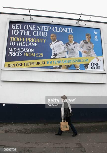 A woman walks past a billboard outside Tottenham Hotspur football club's White Hart Lane stadium in north London on January 24 2011 in London England...