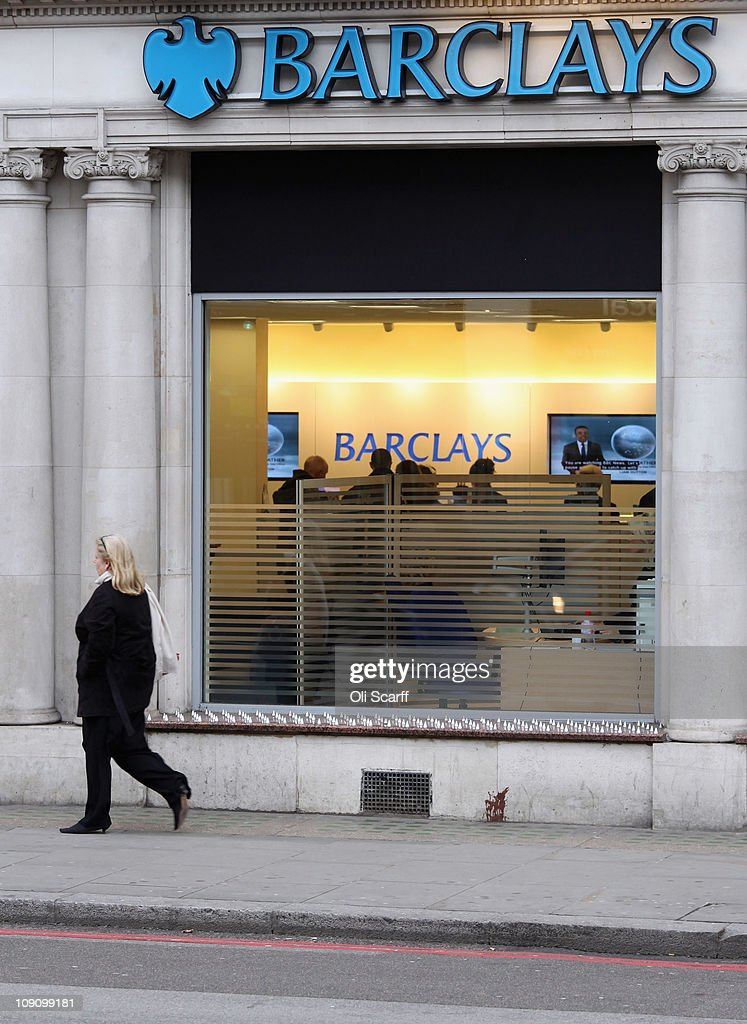 A woman walks past a branch of Barclays bank in central London on February 15 2011 in London England Barclays banking group has today reported pretax...