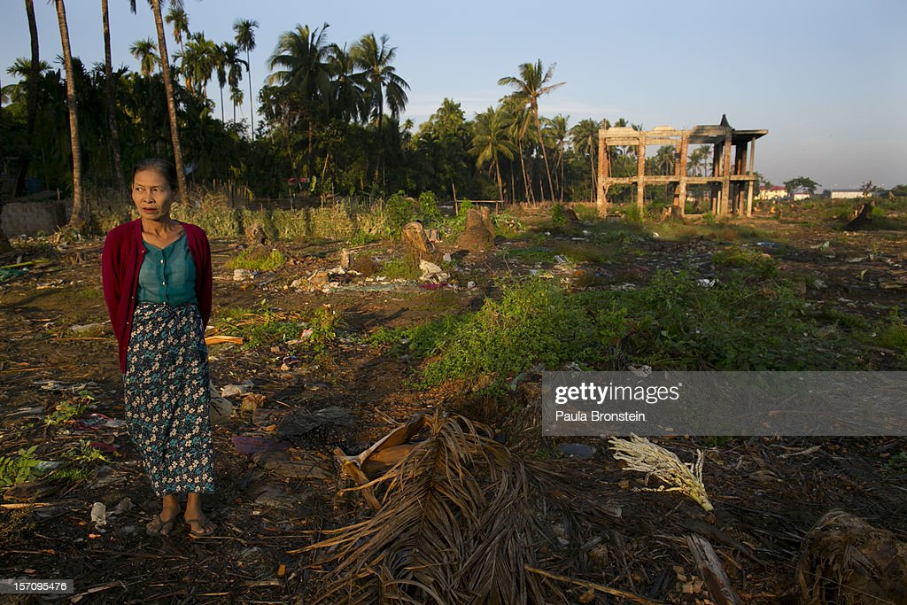 A woman walks past a burnt out area where dozens of families used to live until fires destroyed many homes November 25, 2012 Sittwe, Myanmar. An estimated 111,000 people were displaced by sectarian violence in June and October, effecting mostly the ethnic Rohingya people, who are now living in crowded IDP camps racially segregated from the Rakhine Buddhists in order to maintain stability. Around 89 lives were lost during a week of violence in October, the worst in decades. As of 2012, 800,000 Rohingya live in Myanmar. According to the UN, they are one of the most persecuted minorities in the world.