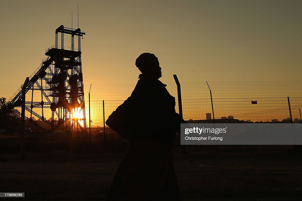 A woman walks past a derelict gold mine shaft's winding gear in front of the setting sun on July 15, 2013 in Johannesburg, South Africa. Johannesburg became the centre of gold mining in 1886 when gold was first discovered. Two government officials were sent to establish a settlement and named it Johannesburg after the first name they both shared. The gold rush lasted for over 100 years. The South African mining industry has shed more than 340,000 jobs since 1990 but is still the fifth largest gold producer in the world and has vast amounts of other minerals still to be unearthed.