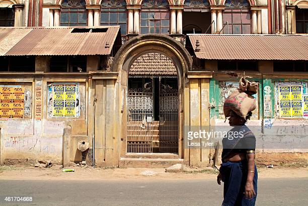A woman walks past a derelict mansion in Karaikudi in the Chettinad region of Tamil Nadu Numbering more than 60 Chettinad's mansions were built by a...