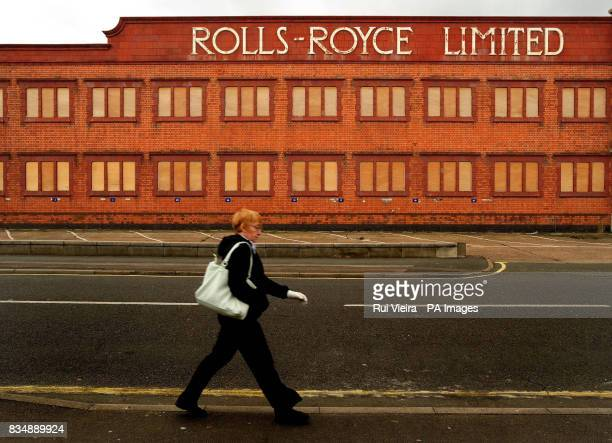 A woman walks past a disused RollsRoyce engineering works in Derby after it was announced that the firm plans to cut up to 2000 jobs worldwide...