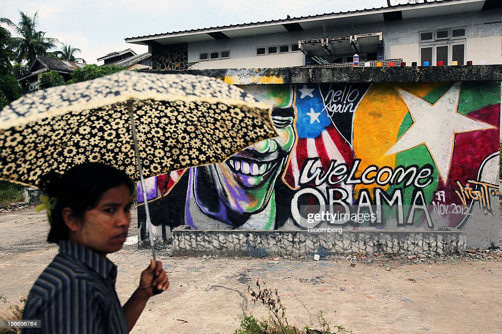 A woman walks past a graffiti by Burmese artist Arker Kyaw welcoming U.S. President <a gi-track='captionPersonalityLinkClicked' href=/galleries/search?phrase=Barack+Obama&family=editorial&specificpeople=203260 ng-click='$event.stopPropagation()'>Barack Obama</a> to Myanmar on a wall in Yangon, Myanmar, on Sunday, Nov. 18, 2012. President <a gi-track='captionPersonalityLinkClicked' href=/galleries/search?phrase=Barack+Obama&family=editorial&specificpeople=203260 ng-click='$event.stopPropagation()'>Barack Obama</a> will become the first sitting U.S. president to visit Myanmar when he travels to Yangon on Nov. 19 to meet President Thein Sein and Aung San Suu Kyi, the opposition leader who spent more than 15 years under house arrest before the country shifted to democracy after decades of military rule. Photographer: Dario Pignatelli/Bloomberg via Getty Images