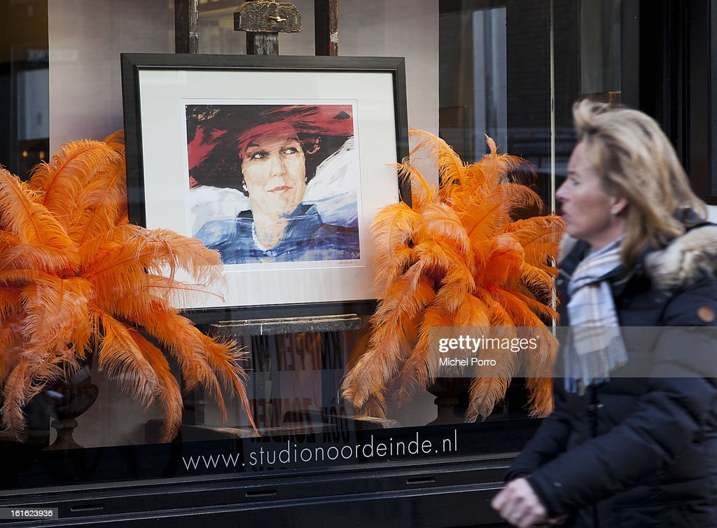 . A woman walks past a hair salon near the Noordeinde Palace displaying a portrait of Queen Beatrix as the nation looks forward to the upcoming coronation of King Willem Alexander on February 13, 2013 in The Hague, Netherlands. The coronation Of Prince Willem Alexander will happen on April 30