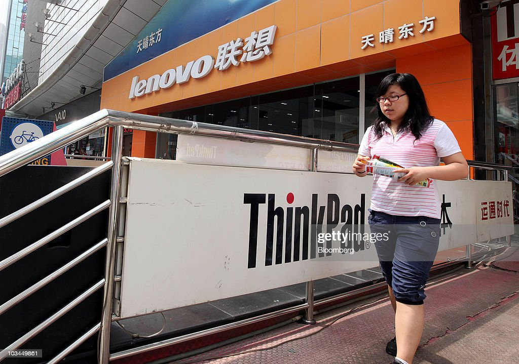 A woman walks past a Lenovo Group Ltd store at a computer market in Beijing China on Thursday Aug 19 2010 Lenovo Group Ltd China's biggest maker of...