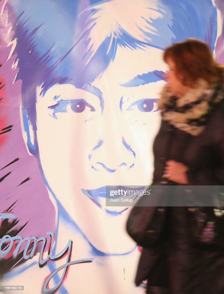 A woman walks past a makeshift memotial to murdered youth Jonny K. at Alexanderplatz on November 21, 2012 in Berlin, Germany. Jonny K. died after a group of youths beat him severely in the early hours of October 14 at Alexanderplatz. Investigations are continuing as three of the suspects remain abroad, one in Turkey and two in Greece.