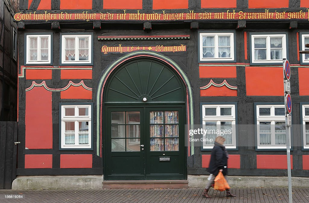 A woman walks past a particularly ornate by half-timbered house on November 19, 2012 in Hoexter, Germany. Hoexter lies along the 'Fairy Tale Road' (in German: Die Maerchenstrasse) that leads through the region between Frankfurt and Bremen where the Grimm brothers collected and adapted most of their fairy tales, which include such global classics as Sleeping Beauty, Little Red Riding Hood, Rapunzel, Cinderella and Hansel and Gretel, in the early 19th century. The 200th anniversary of the first publication of the stories will take place this coming December 20th.