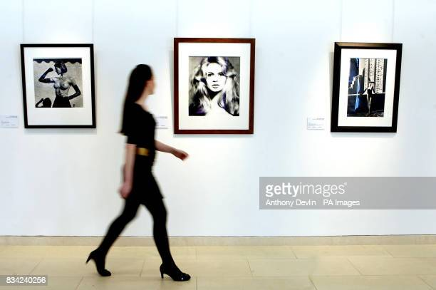 A woman walks past a photograph of Brigitte Bardot by Richard Avedon at Christie's in London part of Gert Elfering's collection