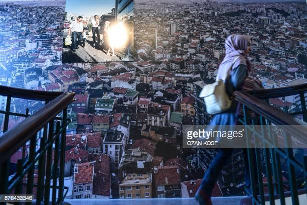 A woman walks past a piece during the 15th Istanbul Biennial on October 20 2017 Almost immediately after the failed coup against Erdogan last year...