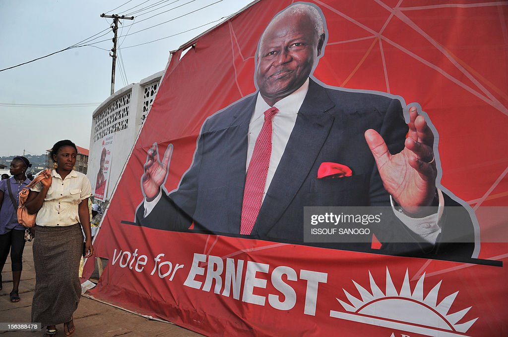 A woman walks past a poster bearing a picture of Sierra Leone's President Ernest Bai Koroma on November 14, 2012 in Freetown, ahead of general elections in Sierra Leone on November 17, 2012. The west African nation, which despite significant advances remains one of the world's poorest and most under-developed a decade after the end of its civil conflict, will also vote for a new parliament.