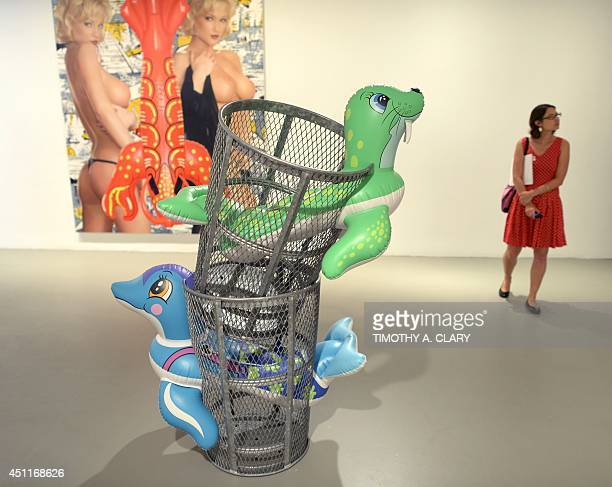 A woman walks past a sculpture by Jeff Koons titled 'Sea Walrus during a press preview of 'Jeff Koons A Retrospective'a exhibition of his work at the...