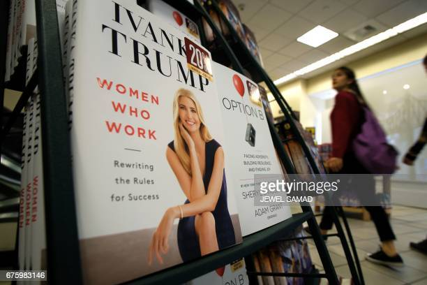 A woman walks past a shelf displaying Ivanka Trump's book 'Women Who Work Rewriting the Rules for Success' at a Barnes and Nobel bookstore in New...