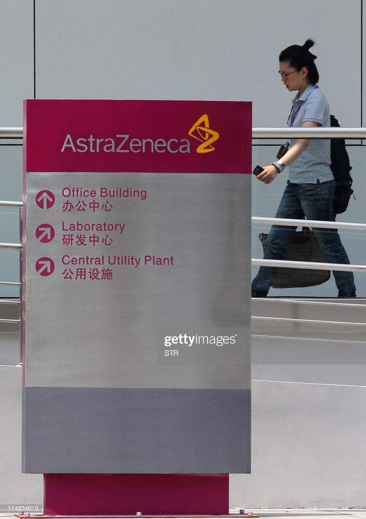 A woman walks past a sign outside the China headquarters of British company AstraZenica in the Zhangjiang district of Shanghai on July 24, 2013. Beijing's targeting of British pharmaceutical giant GlaxoSmithKline (GSK) in a high-profile bribery probe is a reminder of the risks foreign companies face when seeking the huge rewards of China's market, analysts say. Police say GSK staff offered government officials and doctors bribes, and took kick-backs from travel agencies to organise conferences, some of which were fake. Chinese authorities have also questioned three Shanghai-based employees of Britain's AstraZeneca, detaining two, and have visited the offices of Belgium's UCB, according to the companies, although they did not specify what was being investigated. CHINA