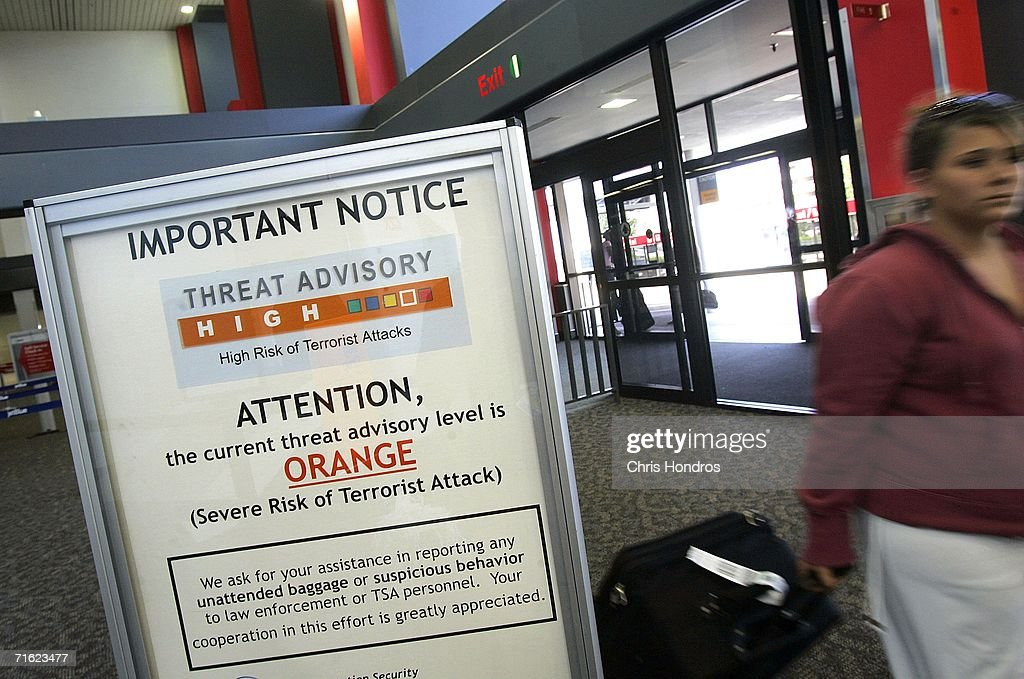 A woman walks past a sign warning passengers of the high threat level at RaleighDurham International Airport August 10 2006 in Wake County North...