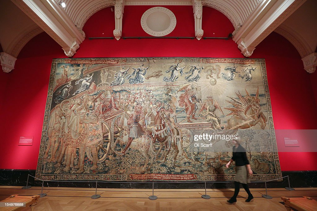 A woman walks past a tapestry entitled 'The triumph of Time over Fame' in the exhibition 'The Northern Renaissance: Durer to Holbein' at The Queen's Gallery on October 29, 2012 in London, England. The exhibition, which celebrates the Renaissance in Northern Europe through work by some of the finest artists of the era, opens to the general public on November 2, 2012 and runs until April 14, 2013.