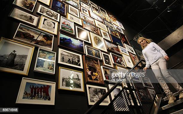A woman walks past a wall covered by National Geographic photographs in the National Geographic store on Regent Street on November 13 2008 in London...