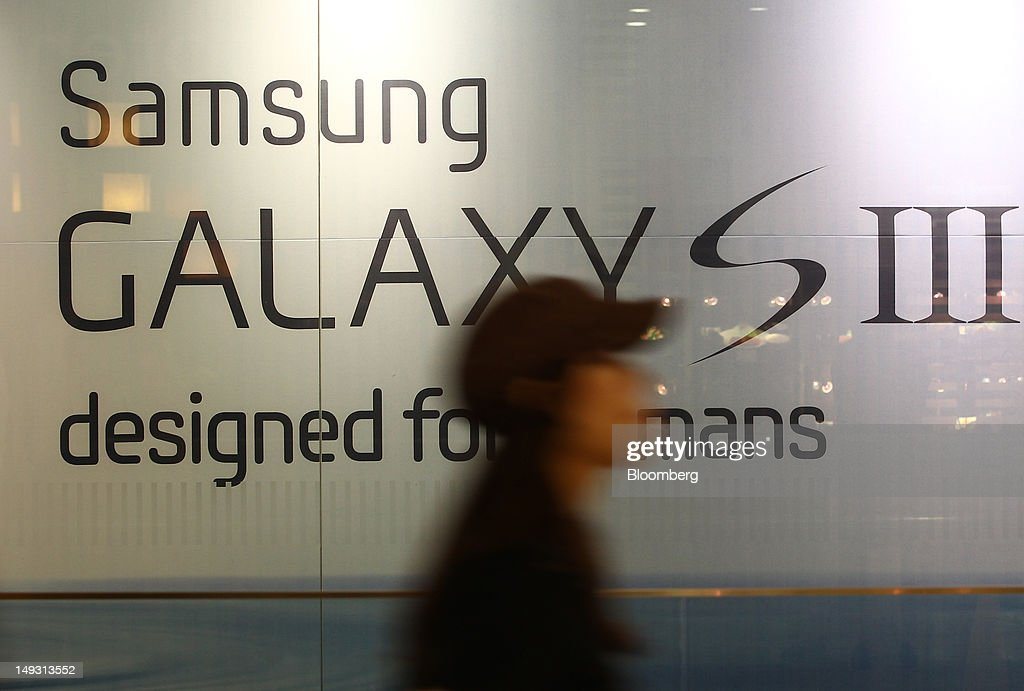 A woman walks past an advertisement for the Samsung Electronics Co. Galaxy S III smartphone at the company's flagship store in Seoul, South Korea, on Thursday, July 26, 2012. Samsung, the world's largest maker of TVs and mobile phones, reported second-quarter profit that missed analysts' estimates after chip prices weakened and smartphone output failed to keep up with demand. Photographer: SeongJoon Cho/Bloomberg via Getty Images