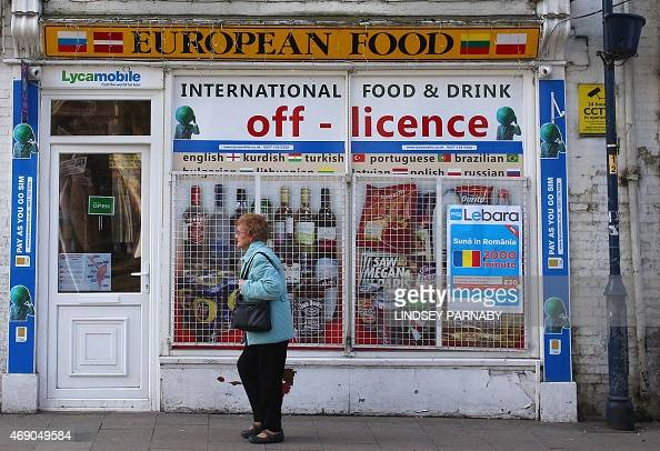 A woman walks past an Eastern European food shop in the market town of Boston in Lincolnshire on March 5 2015 For centuries the town of Boston in...