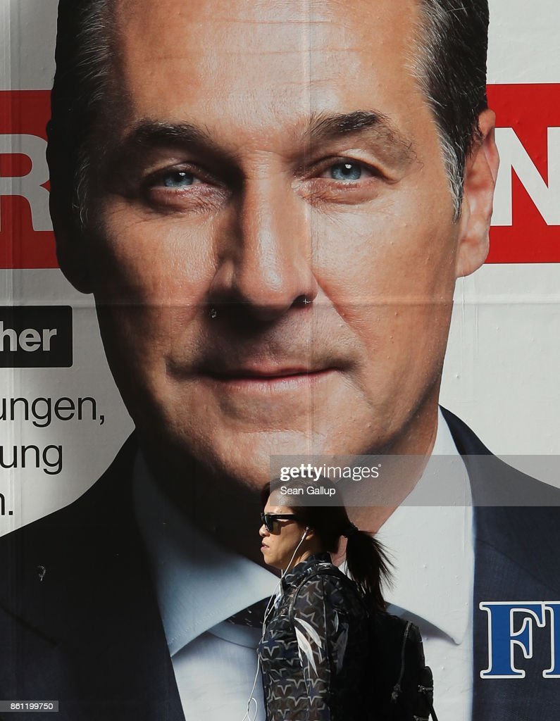 A woman walks past an election campaign billboard that shows Heinz-Christian Strache, lead candidate of the right-wing Austria Freedom Party (FPOe), on October 14, 2017 in Vienna, Austria. Austria faces parliamentary elections on October 15 and the FPOe, which is running on a 'fairness for Austrians' campaign with strong anti-immigrant, anti-refugee and anti-Islam tones, is currently in third place in polls and could well become a coalition partner in the next Austrian government.