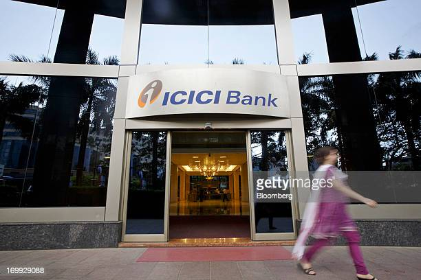 A woman walks past an entrance of ICICI Bank Ltd's head office in Mumbai India on Monday June 3 2013 ICICI Bank India's largest private lender...