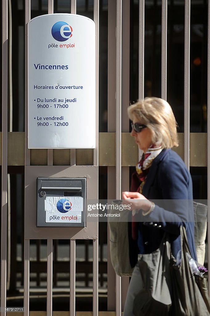 A woman walks past an entrance of the Pole Emploi employment agency on April 24, 2013 in Vincennes, France. French unemployment keeps rising and the number of unemployed people could reach a new historical record in May 2013.