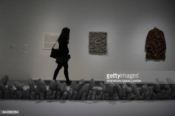 A woman walks past an exhibit during a preview of the Yayoi Kusama's Infinity Mirrors exhibit at the Hirshhorn Museum February 21 2017 in Washington...