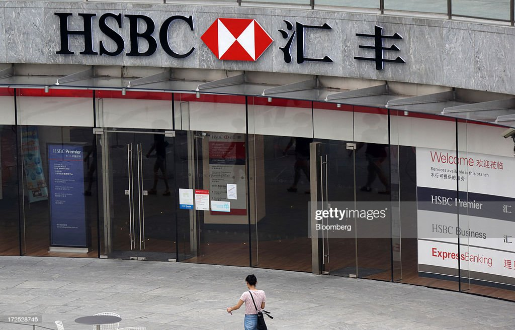 A woman walks past an HSBC Holdings Plc branch in Shanghai, China, on Monday, July 1, 2013. Chinese banks' valuations are close to their lowest on record as the nation's interbank funding crisis exacerbated investors' concern that earnings growth will stall and defaults may surge as the economy slows. Photographer: Tomohiro Ohsumi/Bloomberg via Getty Images