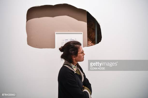 A woman walks past an installation during the 15th Istanbul Biennial on November 3 2017 Almost immediately after the failed coup against Erdogan last...
