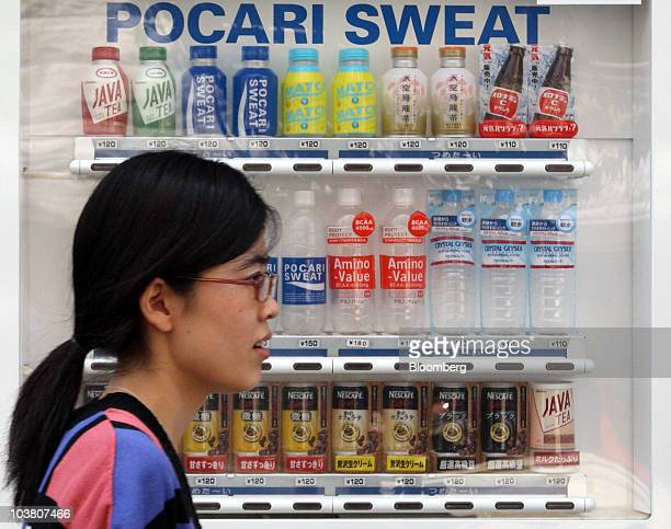 A woman walks past an Otsuka Pharmaceutical Co vending machine in Tokyo Japan on Friday Sept 3 2010 Otsuka Holdings Inc Japan's largest privately...