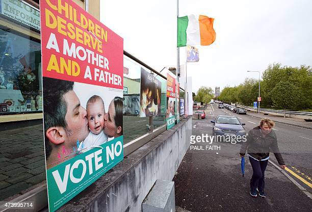 A woman walks past anti samesex 'Vote No' posters in Knock west Ireland on May 18 2015 In the village of Knock in the west of Ireland support for a...