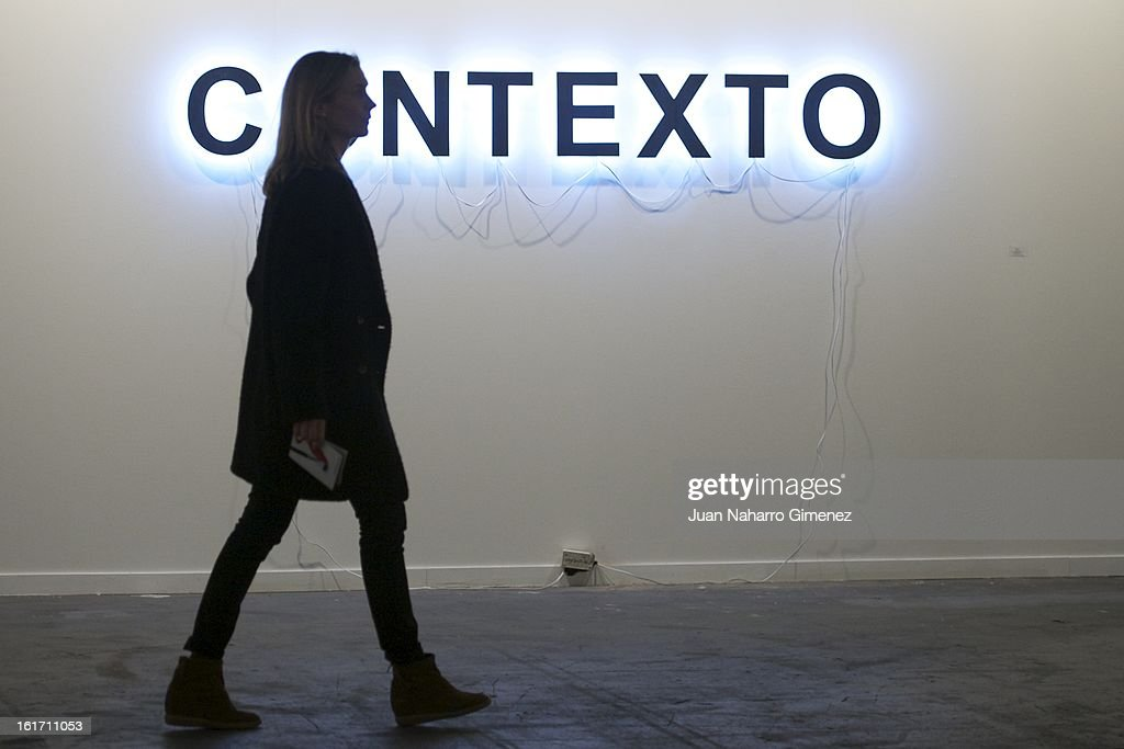 A woman walks past Antoni Muntada's piece at Galerie Moises Perez de Albeniz from Spain during the 'Feria Internacional de Arte Contemporaneo' (ARCO) at Ifema on February 14, 2013 in Madrid, Spain.