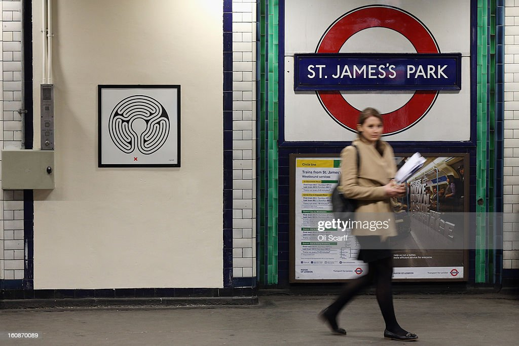 A woman walks past artwork by Mark Wallinger on the platform of St James's Park Station as part of London Underground's largest ever art commission on February 7, 2013 in London, England. Mr Wallinger has been commissioned to produce artworks in all 270 stations on the Underground network to celebrate the 150 year anniversary of the tube opening.