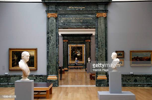 A woman walks past artwork on display at the Walk through British Art exhibition at Tate Britain on May 13 2013 in London England Visitors will...
