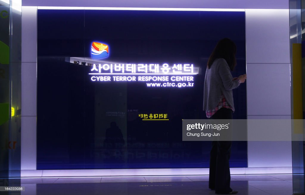 A woman walks past at Cyber Terror Response Center at National Police Agency on March 21, 2013 in Seoul, South Korea. A cyber attack on the computer networks that run three South Korean banks, two broadcasters and an internet service provider in South Korea yesterday has been traced to an IP address in China, despite many experts suspecting the attacks to originate in North Korea. Officials noted that while the attack was traced to an IP address it China may have originated elsewhere and been routed through the country to disguise the attackers.