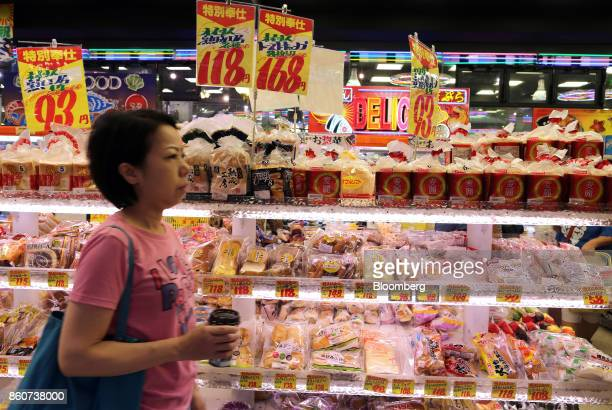 A woman walks past bread on shelves at a Super Tamade KK supermarket in the Tenjinbashi district of Osaka Japan on Monday Oct 9 2017 Amid the gloom...