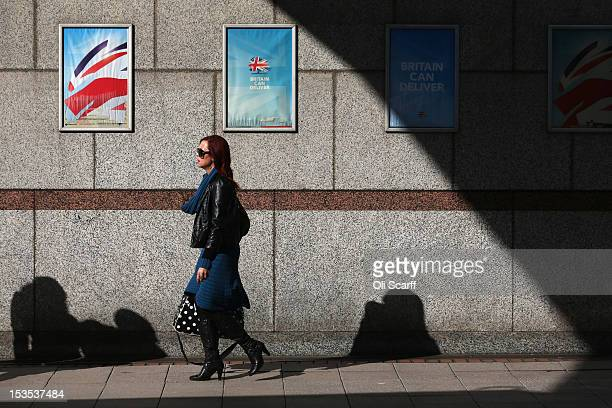 A woman walks past Conservative party posters on the outside the International Convention Centre on October 6 2012 in Birmingham England The annual...