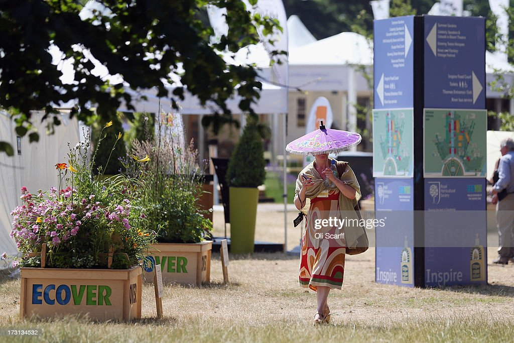A woman walks past exhibition stands at the Hampton Court Palace Flower Show on July 8, 2013 in London, England. Hampton Court Palace Flower Show opens to the public tomorrow and runs until July 14, 2013. It is the world's largest flower show with over 600 exhibitors spread over 34 acres.