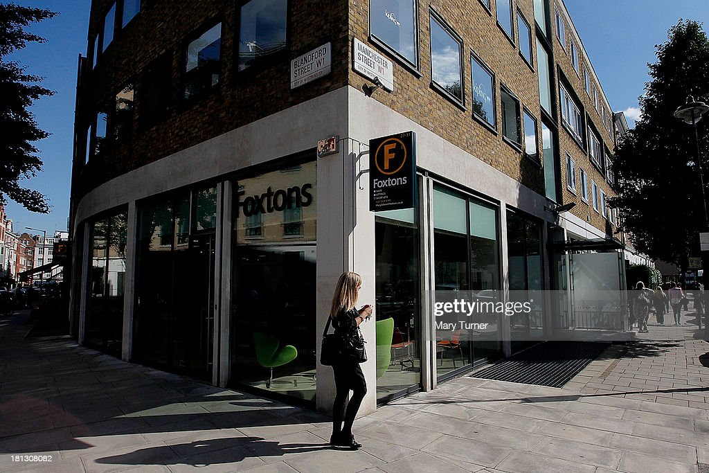 A woman walks past Foxtons Estate Agents in Marylebone on September 20, 2013 in London, England. Foxtons has been valued at £649 million ahead of its full stock market listing. Shares in the company were priced at GBP 2.30 each.