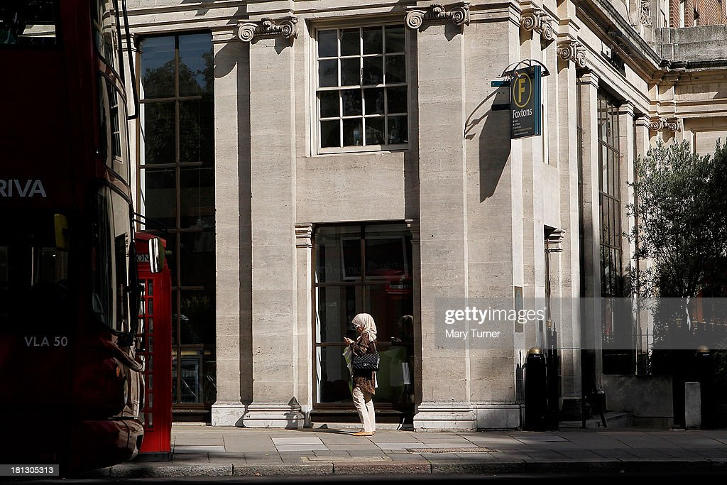 A woman walks past Foxtons Estate Agents in Mayfair on September 20, 2013 in London, England. Foxtons has been valued at £649 million ahead of its full stock market listing. Shares in the company were priced at GBP 2.30 each.
