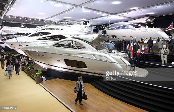 A woman walks past huge Sunseeker power boats positioned in the ExCeL exhibition centre on the opening day of the London International Boat Show on...