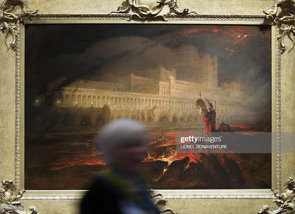 A woman walks past 'Le Pandemonium' painting by John Martin, displayed during the exhibition 'The Angel of the Odd. Dark Romanticism from Goya to Max Ernst' at the Orsay museum in Paris, on March 4, 2013. The exhibition will run from March 5 until June 9, 2013. AFP PHOTO / LIONEL BONAVENTURE CAPTION