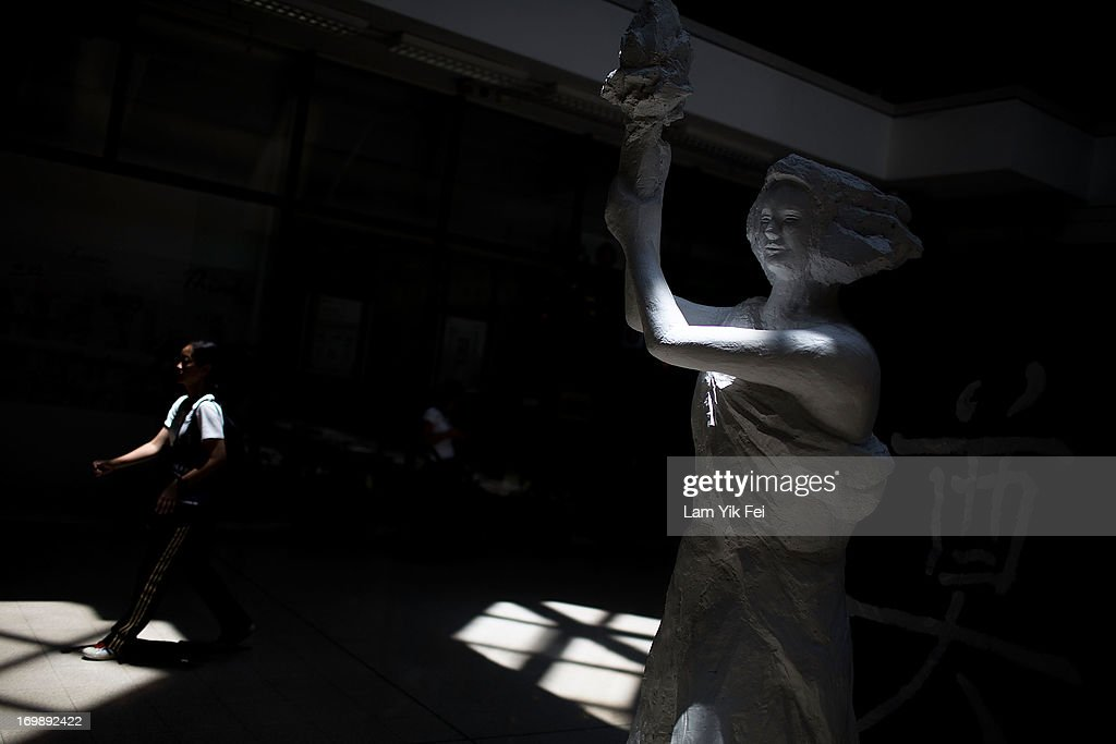 A woman walks past of the Goddess of Democracy at the 'June 4 Memorial Museum' run by pro-democracy activists at City University on June 4, 2013 in Hong Kong. Pro-democracy groups hope to draw 150,000 people to the annual candlelight vigil in Hong Kong's Victoria Park, the only commemoration on Chinese soil, to remember the 24th anniversary of the Tiananmen Square crackdown.