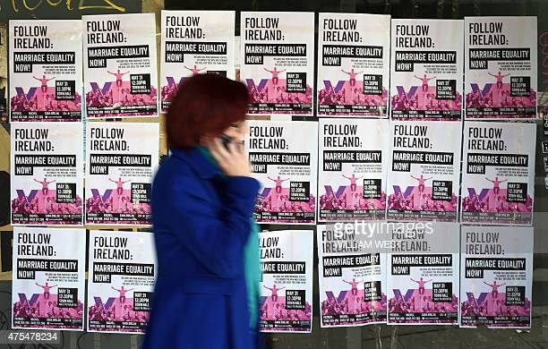 A woman walks past posters in Sydney's Oxford Street advertising a rally supporting samesex marriages as Australia's opposition Labor party...