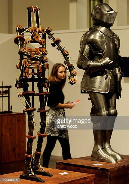 A woman walks past robotic models which form part of the Leonardo da Vinci exhibition Da Vinci Secrets 'Anatomy to Robots' at the Sydney Town Hall on...